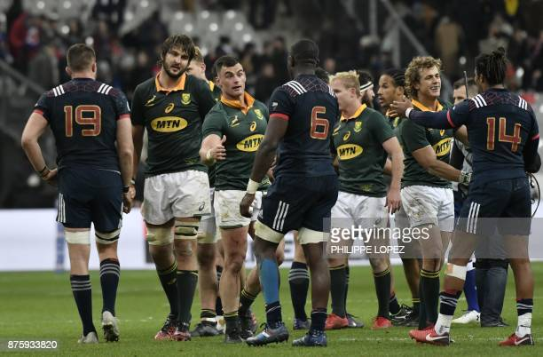 South Africa's centre Jesse Kriel shakes hands with France's flanker Judicaël Cancoriet after the friendly rugby union international Test match...