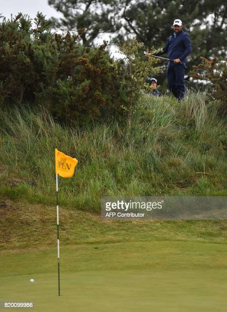 South Africa's Charl Schwartzel watches the result of his chip from behind the 5th green during his second round on day two of the Open Golf...