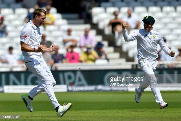 South Africa's Chris Morris celebrates with South Africa's captain Faf du Plessis after bowling out England's Joe Root for 8 runs on the fourth day...