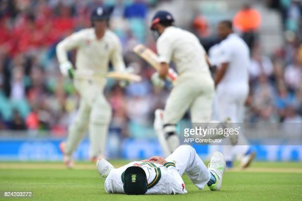 South Africa's Chris Morris lies on the grass after missing a catch as England's batsmen take a run during play on day 3 of the third Test match...