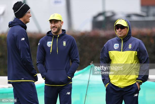 South Africa's Chris Morris South Africa's captain Faf du Plessis and South Africa's coach Russell Domingo attend a nets practice session at Old...