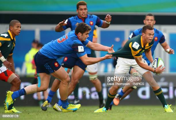South Africa's Cirwin Bosch is tackled by France's Damian Penaud