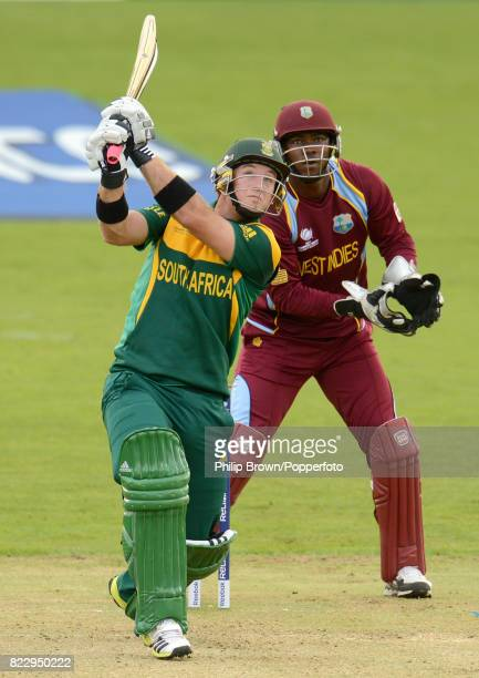 South Africa's Colin Ingram hits a six during his innings of 73 runs watched by West Indies wicketkeeper Johnson Charles in the ICC Champions Trophy...