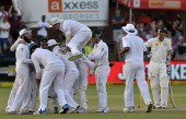 South Africa's cricketers celebrate their win over Australia in the second test match between South Africa and Australia at St George's Park in Port...
