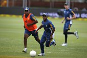 South Africa's cricketers Temba Bavuma Vernon Philander and Morne Morkel warm up ahead of the 4th day of the second test match between South Africa...