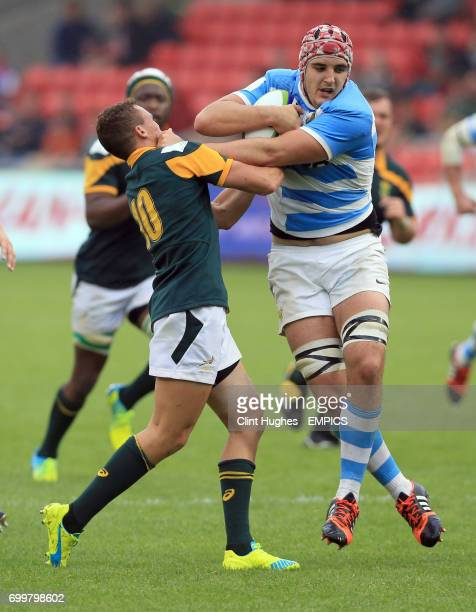 South Africa's Curwin Bosch tackles Argentina's Franco Molina during the Under 20's Rugby Union World Cup match at the AJ Bell Stadium Salford
