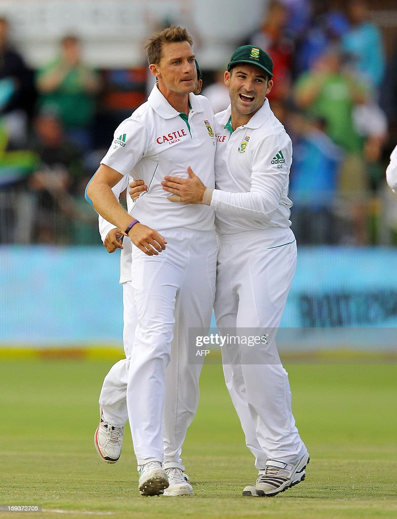South Africa's Dale Steyn (L) and Dean Elgar ofcelebrate the wicket of New Zealand's Kane Williamson on January 12, 2013 on the second day of the second and final Test at St George's Park in Port Elizabeth. PHOTO /Anesh Debiky