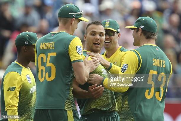 South Africa's Dane Paterson celebrates with teammates after taking the wicket of England's Liam Livingstone during the third Twenty20 international...