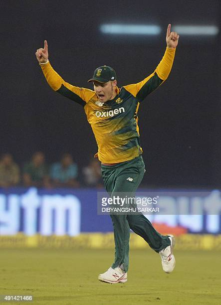 South Africa's David Miller celebrates after running out India's Rohit Sharma during the second T20 cricket match between India and South Africa at...
