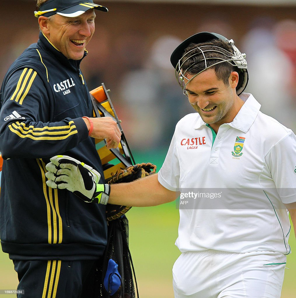 South Africa's Dean Elgar (R) is congratulated by former South African cricketer Allan Donald (L) after making 100 runs on January 12, 2013 on the second day of the second and final Test against New Zealand at St George's Park in Port Elizabeth. AFP PHOTO /Anesh Debiky