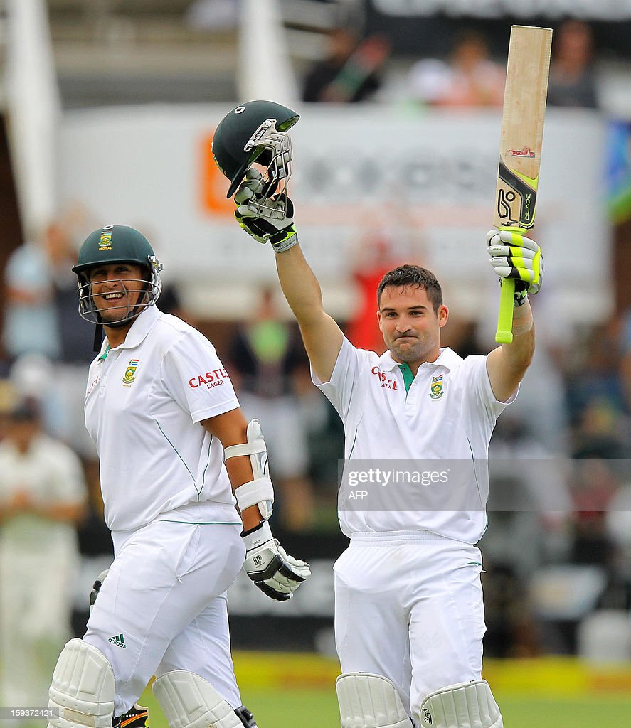 South Africa's Dean Elgar raises his hands to celebrate his 100 runs on January 12, 2013 on the second day of the second and final Test against New Zealand at St George's Park in Port Elizabeth. PHOTO /Anesh Debiky