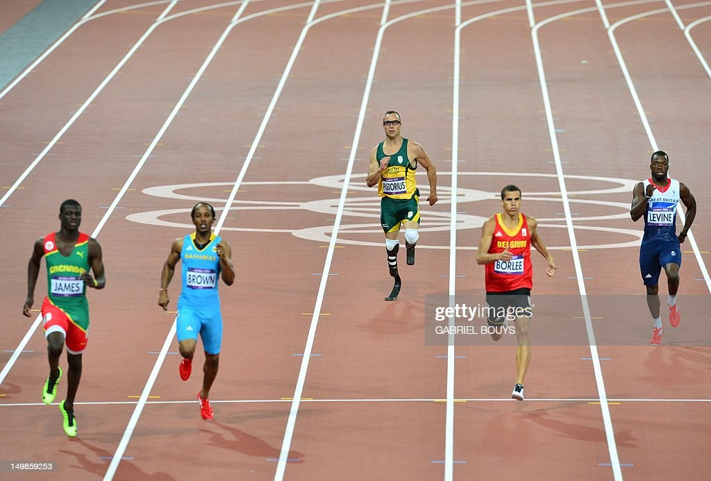 South Africa's double amputee runner Oscar Pistorius (C) competes in the men's 400m semi-finals at the athletics event during the London 2012 Olympic Games on August 5, 2012 in London. AFP PHOTO / GABRIEL BOUYS
