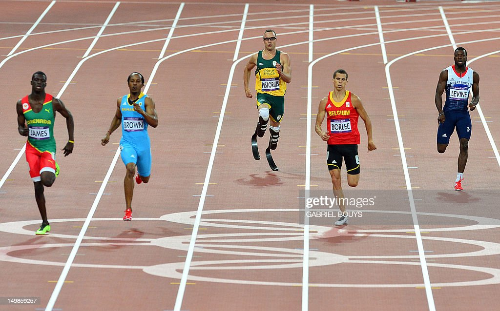 South Africa's double amputee runner Oscar Pistorius (C) competes in the men's 400m semi-finals at the athletics event during the London 2012 Olympic Games on August 5, 2012 in London.