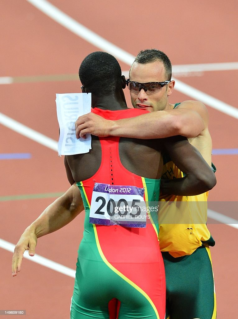 South Africa's double amputee runner Oscar Pistorius (R) greets Grenada's Kirani James (L) after competing in the men's 400m semi-finals at the athletics event during the London 2012 Olympic Games on August 5, 2012 in London.