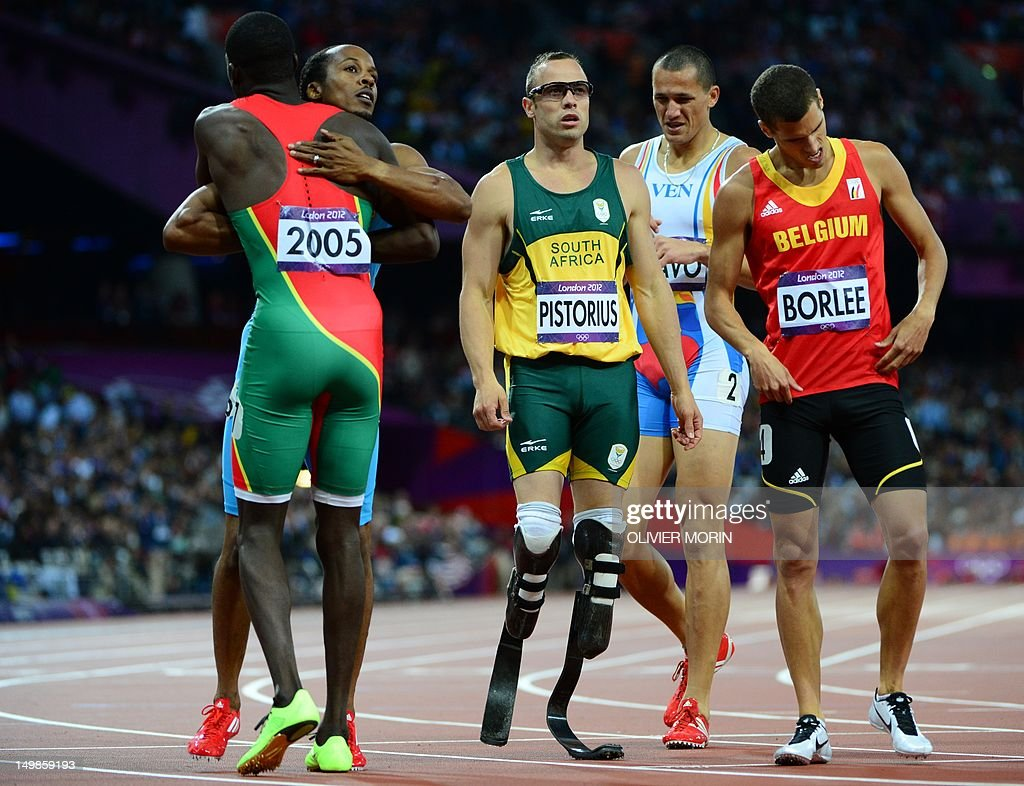 South Africa's double amputee runner Oscar Pistorius (C), Grenada's Kirani James (L) Belgium's Jonathan Borlee reatc after competing in the men's 400m semi-finals at the athletics event during the London 2012 Olympic Games on August 5, 2012 in London.