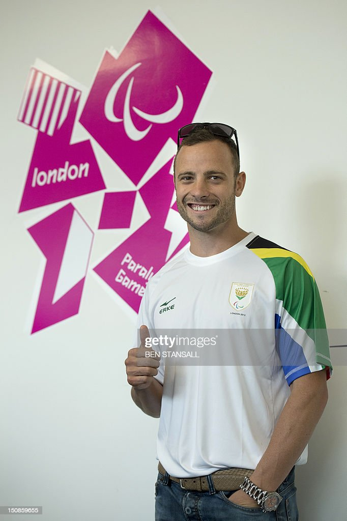 South Africa's double amputee runner Oscar Pistorius poses during a press conference ahead of the London 2012 Paralympic Games in the Olympic park in east London on August 28, 2012. AFP PHOTO / BEN STANSALL