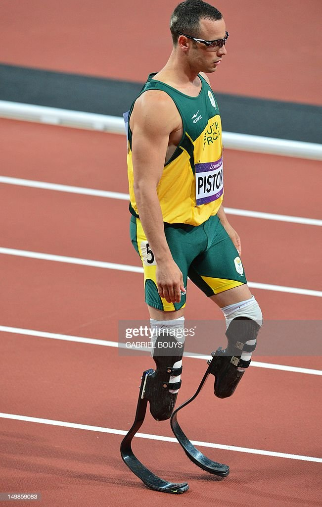 South Africa's double amputee runner Oscar Pistorius prepares before competing in the men's 400m semi-finals at the athletics event during the London 2012 Olympic Games on August 5, 2012 in London. AFP PHOTO / GABRIEL BOUYS
