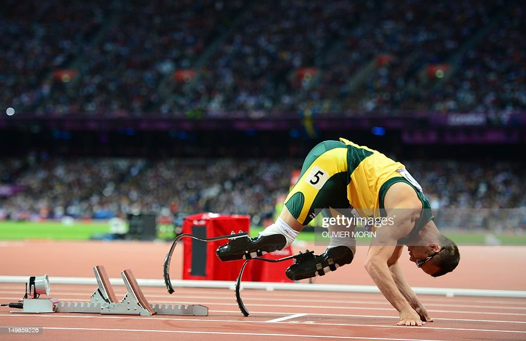 South Africa's double amputee runner Oscar Pistorius prepares before competing in the men's 400m semi-finals at the athletics event during the London 2012 Olympic Games on August 5, 2012 in London.