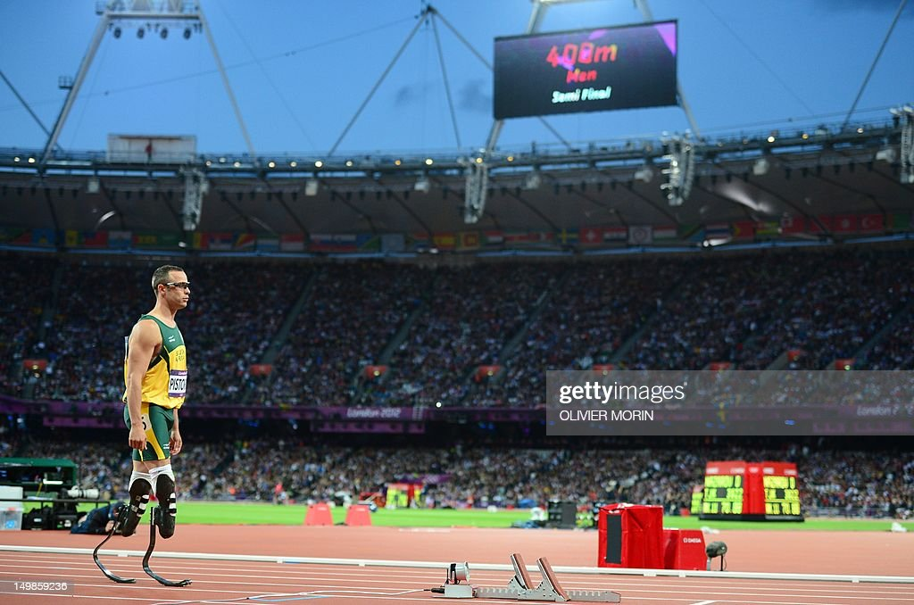 South Africa's double amputee runner Oscar Pistorius prepares before competing in the men's 400m semi-finals at the athletics event during the London 2012 Olympic Games on August 5, 2012 in London. AFP PHOTO / OLIVIER MORIN