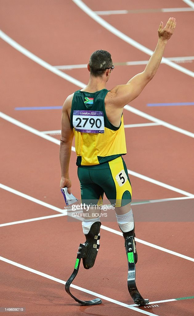 South Africa's double amputee runner Oscar Pistorius waves after competing in the men's 400m semi-finals at the athletics event during the London 2012 Olympic Games on August 5, 2012 in London. AFP PHOTO / GABRIEL BOUYS