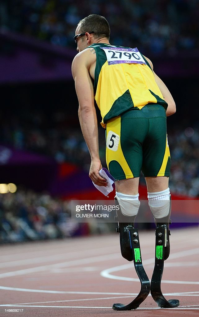 South Africa's double amputee runner Oscar Pistorius waves after competing in the men's 400m semi-finals at the athletics event during the London 2012 Olympic Games on August 5, 2012 in London.