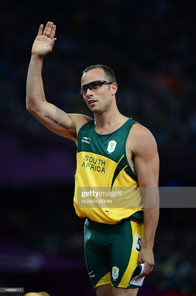 South Africa's double amputee runner Oscar Pistorius waves to supporters after competing in the men's 400m semi-finals at the athletics event during the London 2012 Olympic Games on August 5, 2012 in London.