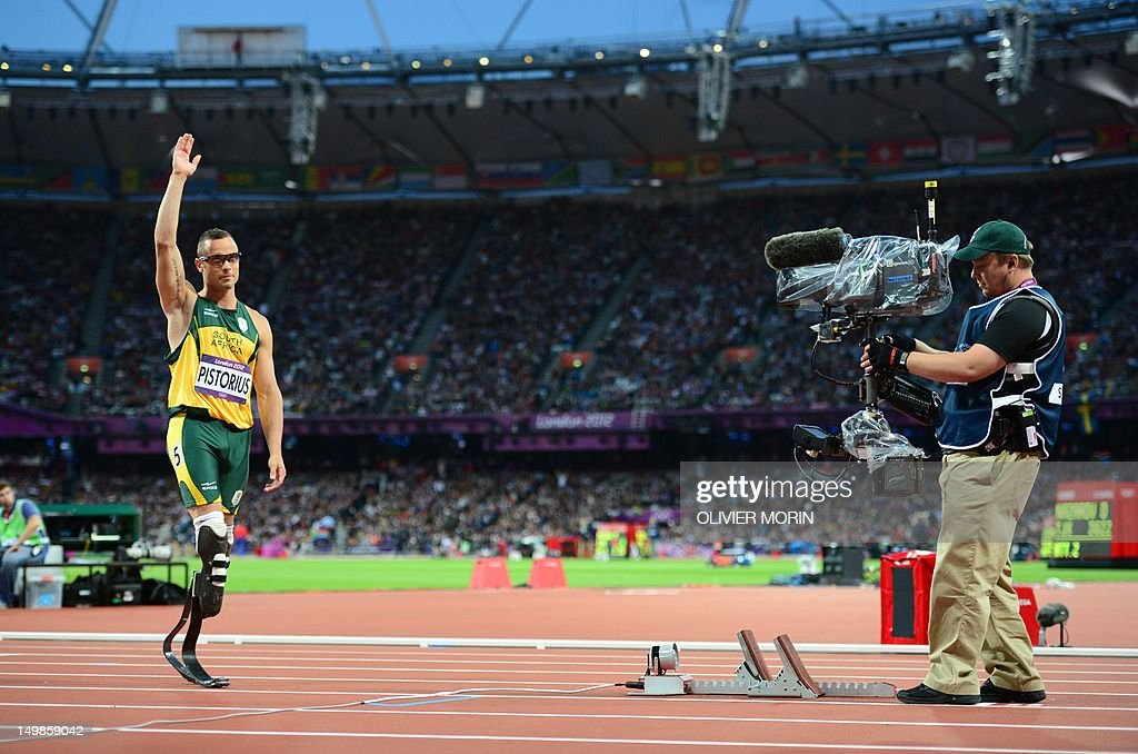 South Africa's double amputee runner Oscar Pistorius waves to supporters bafore ciompeting in the men's 400m semi-finals at the athletics event during the London 2012 Olympic Games on August 5, 2012 in London.