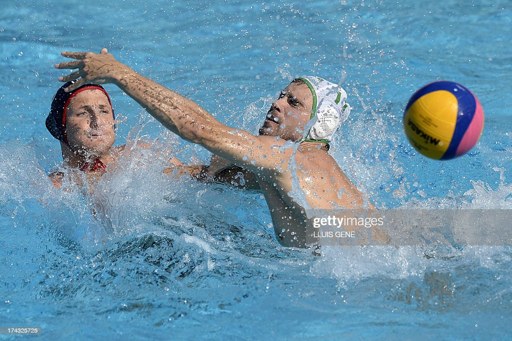 South Africa's Down Stewart (R) vies with US player Anthony Azevedo (L) during the preliminary round match of the men's water polo competition between the US and South Africa at the FINA World Championships at the Bernat Picornell swimming pool in Barcelona on July 24, 2013. AFP PHOTO/ LLUIS GENE