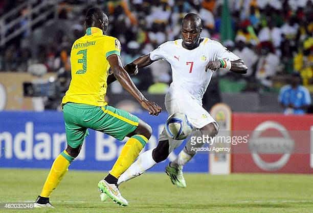South Africa's Eric Mathoho vies for ball with Senegal's Moussa Sow during the 2015 African Cup of Nations Group C football match between South...
