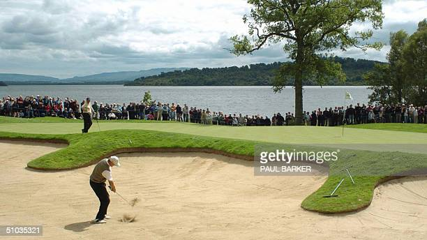 South Africa's Ernie Els digs shoots out of a sand trap on the 5th hole on the first day of the Scottish Open Golf Tornament being held at Loch...