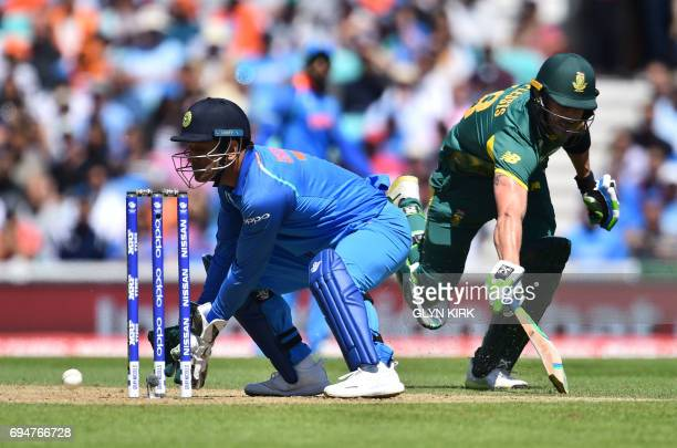 South Africa's Faf du Plessis avoids a runout by India's MS Dhoni during the ICC Champions Trophy match between South Africa and India at The Oval in...