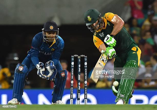 South Africa's Faf du Plessis bats as Sri Lanka's Kumar Sangakkara looks on during the 2015 Cricket World Cup quarterfinal match between South Africa...