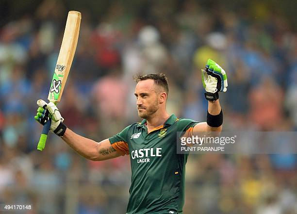 South Africa's Faf du Plessis celebrates after scoring a century during the fifth one day international cricket match between India and South Africa...