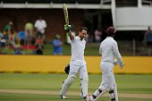 South Africa's Faf du Plessis celebrates reaching a century during the second day of the second cricket Test match between South Africa and the West...