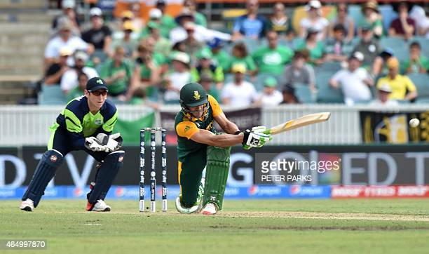 South Africa's Faf du Plessis hits a shot as Ireland's wicketkeeper Gary Wilson looks on during the 2015 Cricket World Cup Pool B match between...
