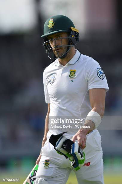 South Africa's Faf du Plessis leaves the field after being caught behind for 61 runs during day four of the Fourth Investec Test at Emirates Old...