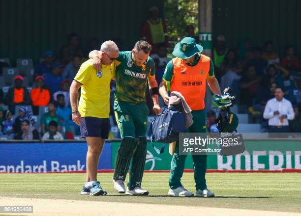South Africa's Faf du Plessis leaves the field after being injury during their ODI oneday international match at the Buffalo Park Cricket Grounds in...