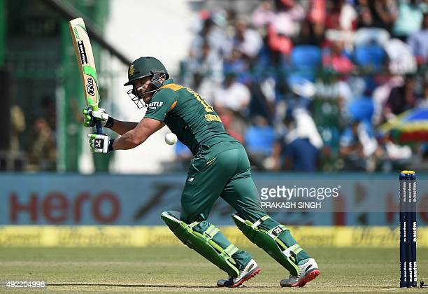 South Africa's Faf du Plessis plays a shot during the first one day international cricket match between India and South Africa at Green Park Stadium...