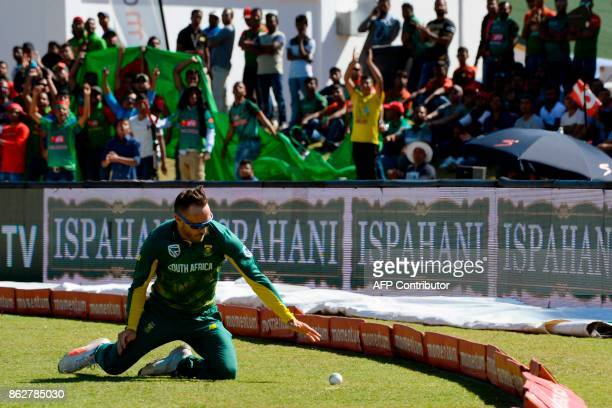 South Africa's Faf du Plessis tries to catch the ball during the second one day international cricket match between South Africa and Bangladesh at...