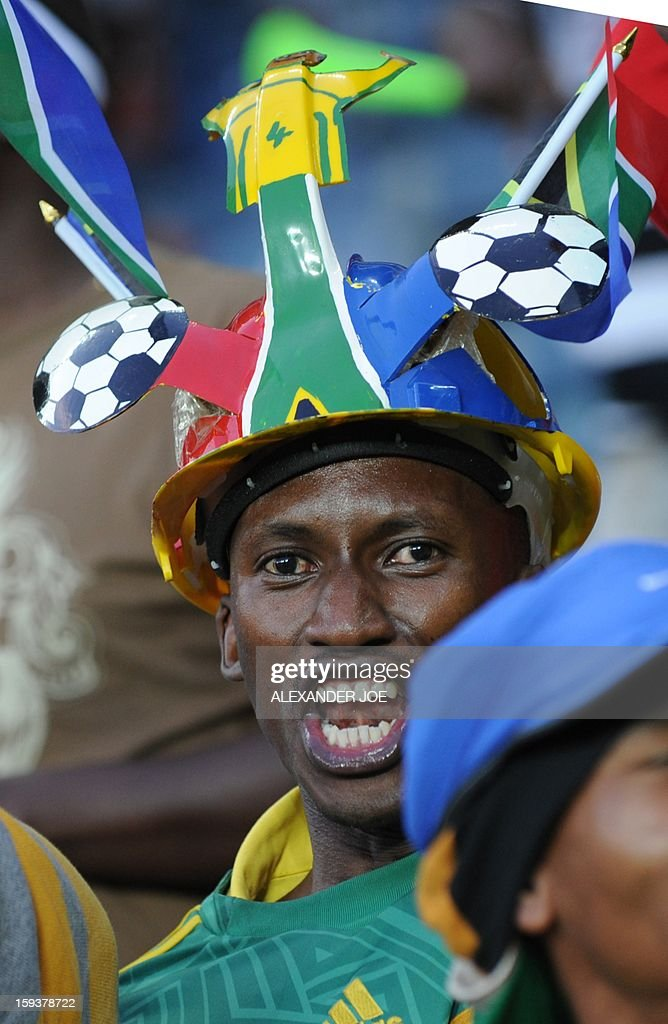 A South Africa's fan cheers during a friendly football match between South Africa's Bafana Bafana and Algeria in Soweto on January 12 , 2013, ahead of the 2013 African Cup of nation that will take place in South Africa from January 19 to February 10.