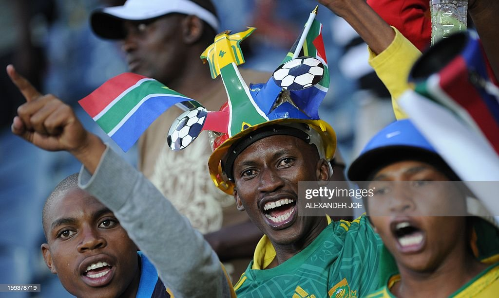 South Africa's fans cheer during a friendly football match between South Africa's Bafana Bafana and Algeria in Soweto on January 12 , 2013, ahead of the 2013 African Cup of nation that will take place in South Africa from January 19 to February 10.