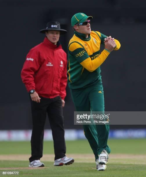 South Africa's fielder David Miller catches Pakistan batsman Muhammad Hafeez off bowler Chris Morris during the ICC Champions Trophy match at...