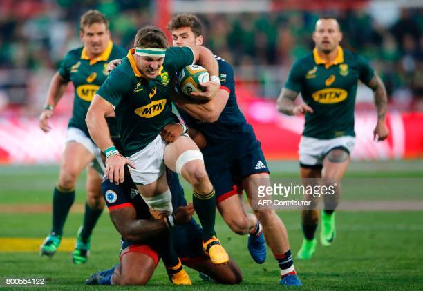 South Africa's flanker Jaco Kriel is tackled during the third rugby union Test match between South Africa and France at The Emirates Ellis Park...