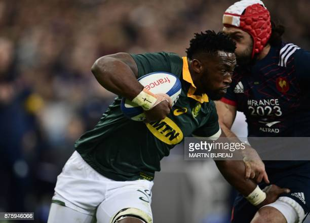 South Africa's flanker Siya Kolisi runs with the ball during the friendly rugby union international Test match between France and South Africa's...
