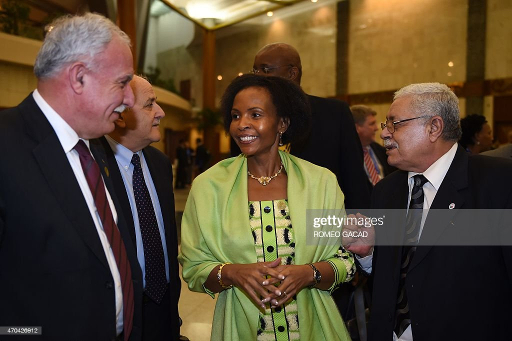 South Africa's Foreign Minister <a gi-track='captionPersonalityLinkClicked' href=/galleries/search?phrase=Maite+Nkoana-Mashabane&family=editorial&specificpeople=3056332 ng-click='$event.stopPropagation()'>Maite Nkoana-Mashabane</a> (C) speaks to Palestinian delegation, Foreign Affairs Minister Riyad al-Malki (L), Ambassador to UN Riyad Mansour (2nd L) and Ambassador to Indonesia Fariz Mehdawi (4th L) at the conclusion of the Asian African Conference ministerial meeting in Jakarta April 20, 2015. Asian and African leaders gather in Indonesia this week to mark 60 years since a landmark conference that helped forge a common identity among emerging states, but analysts say big-power rivalries will overshadow proclamations of solidarity. AFP PHOTO / ROMEO GACAD