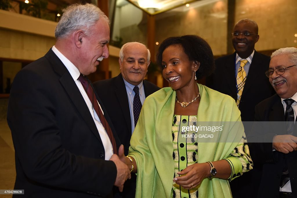 South Africa's Foreign Minister Maite Nkoana-Mashabane (C) speaks to Palestinian delegation, Foreign Affairs Minister Riyad al-Malki (L), Ambassador to UN Riyad Mansour (2nd L) and Ambassador to Indonesia Fariz Mehdawi (5th L) at the conclusion of the Asian African Conference ministerial meeting in Jakarta April 20, 2015. Asian and African leaders gather in Indonesia this week to mark 60 years since a landmark conference that helped forge a common identity among emerging states, but analysts say big-power rivalries will overshadow proclamations of solidarity. AFP PHOTO / ROMEO GACAD