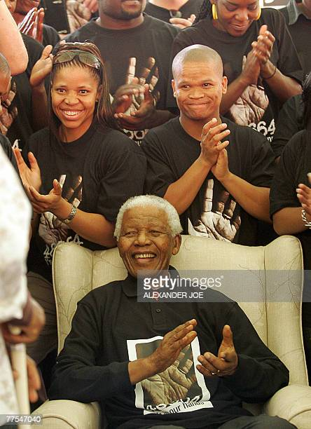 South Africa's former President Nelson Mandela poses with some of the local musical talent 29 October 2007 who will be performing at the 46664 AIDS...