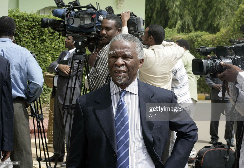 South Africa's former president Thabo Mbeki walks past journalists as he leaves after a meeting with Sudanese President on July 25, 2013 in the Sudanese capital, Khartoum. Mbeki said they discussed the regional panel launched this week to investigate allegations by Sudan and South Sudan that they are supporting rebels operating in each other's territory.