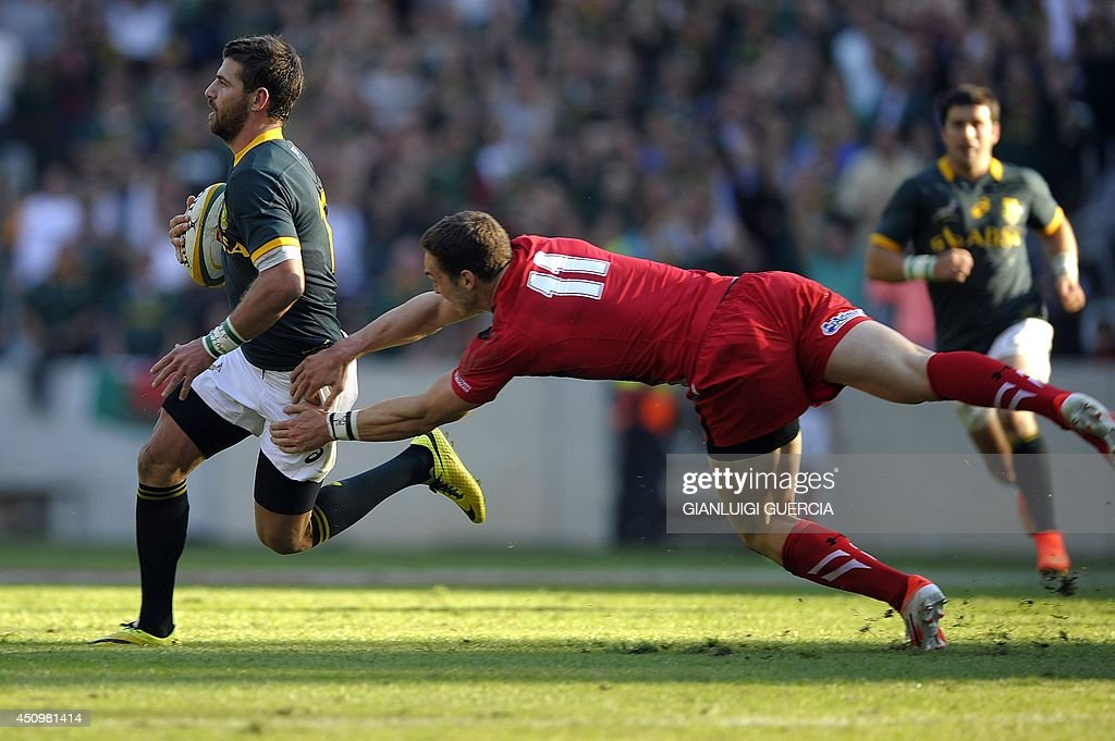 South Africa's fullback Willie le Roux (L) is tackled by Wales' wing George North during the second rugby Test match between South Africa and Wales at Mbombela Stadium in Nelspruit, South Africa, on June 21, 2014.