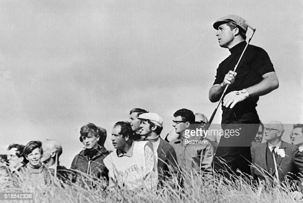 South Africa's Gary Player seems to onehand it as he fires out of the rough on second fairway during second round play in the British Open Golf...